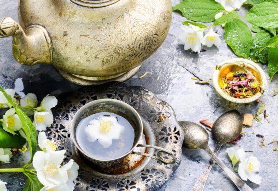 Oriental tea set with tea from jasmine flowers.Green tea